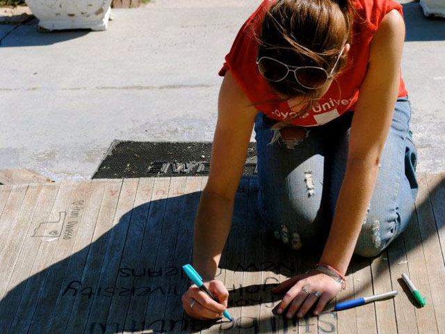 A LUCAP volunteer signs the Joplin House.