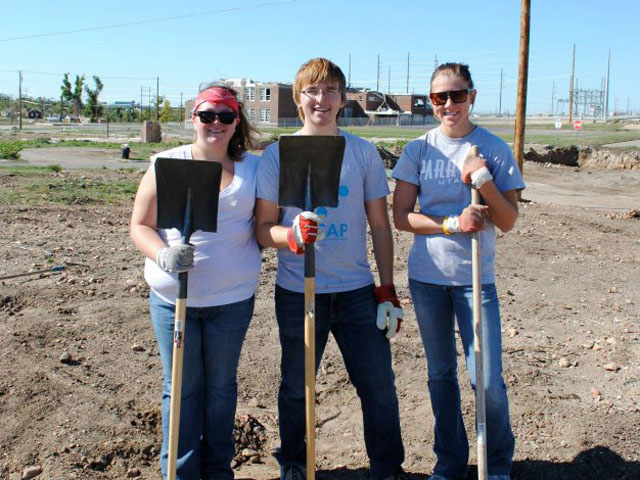 LUCAP volunteers standing in Joplin, MO with shovels.